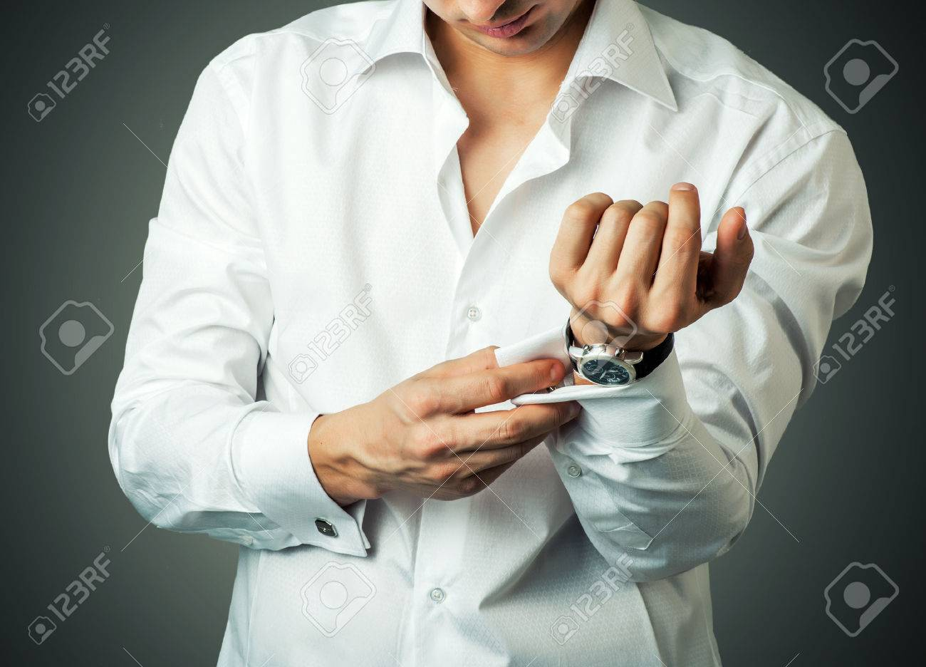 Sexy man buttons cuff-link on French cuffs sleeves luxury white shirt Stock Photo - 24443010