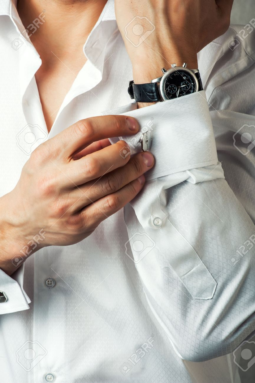 Sexy man buttons cuff-link on French cuffs sleeves luxury white shirt Stock Photo - 24459865