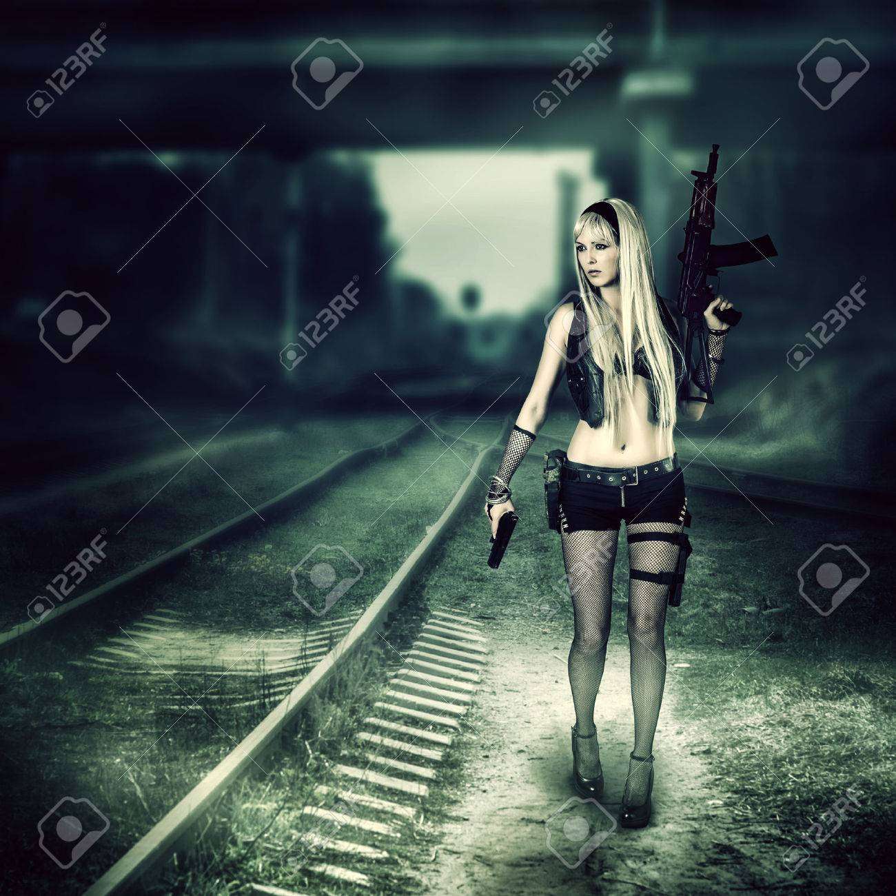 Sexy blond woman killer holding automatic and gun Stock Photo - 27367732