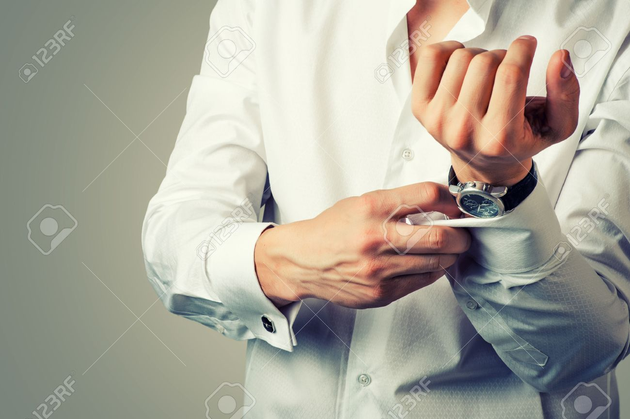 Sexy man buttons cuff-link on French cuffs sleeves luxury white shirt. Tonal correction Stock Photo - 32086080