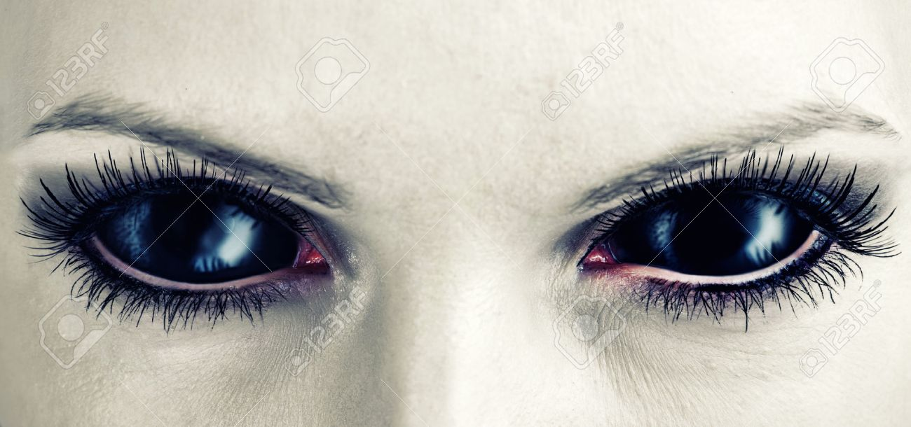 Evil black female alien, vampire or zombie eyes. dirt make up. Macro. Halloween theme Stock Photo - 32723010