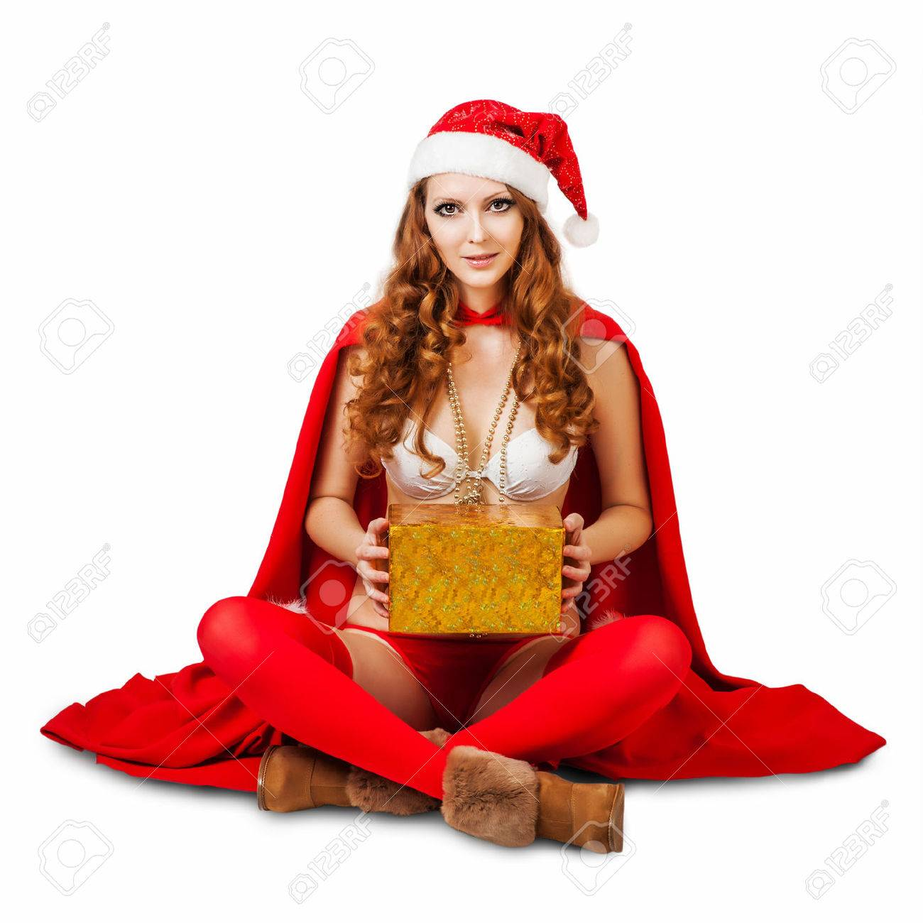 0bcdce8893665 Sexy christmas woman wearing bikini and red santa claus hat holding gift  boxes isolated on white