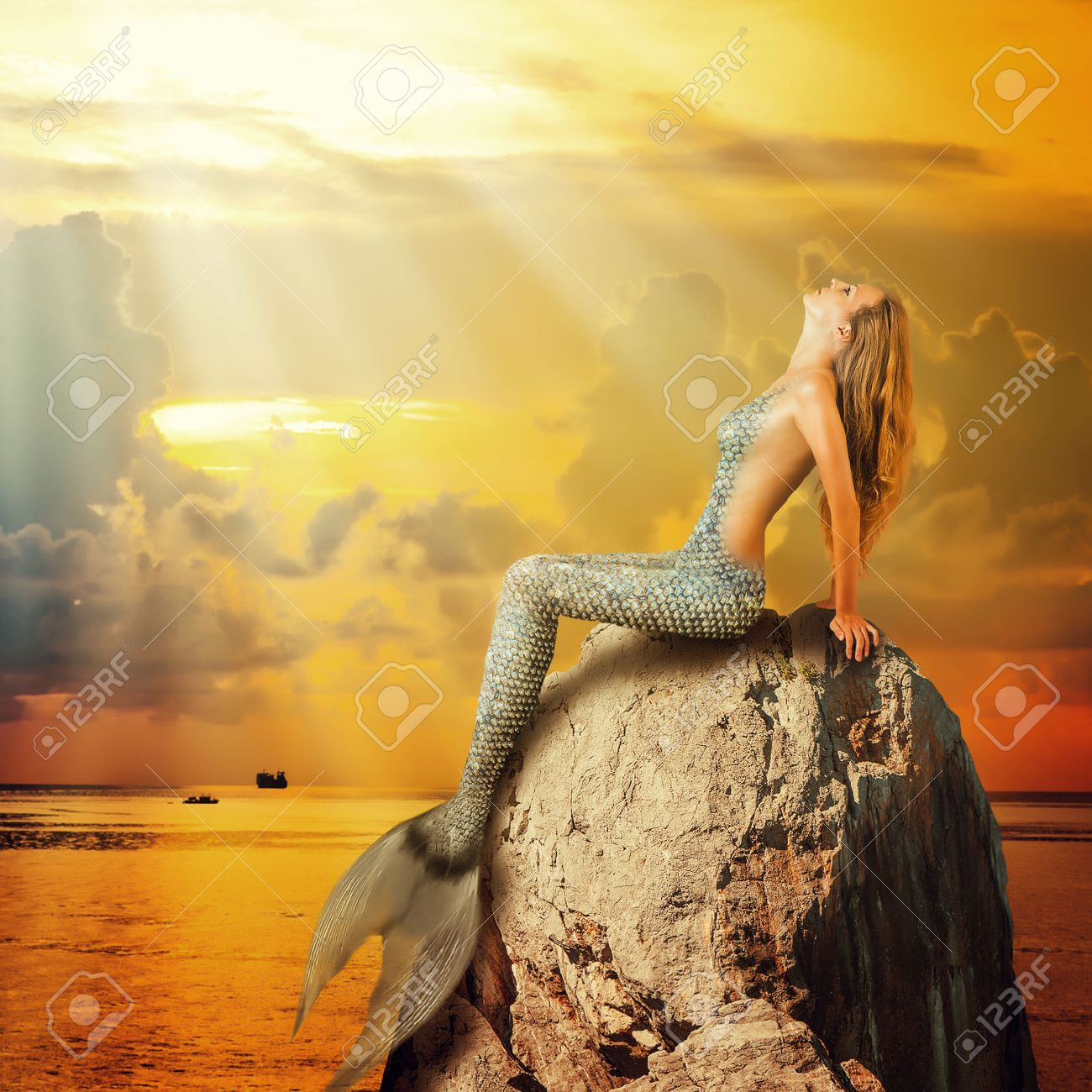 Fantasy. beautiful woman mermaid with fish tail and long developing hair swimming in the sea underwater Stock Photo - 40818220
