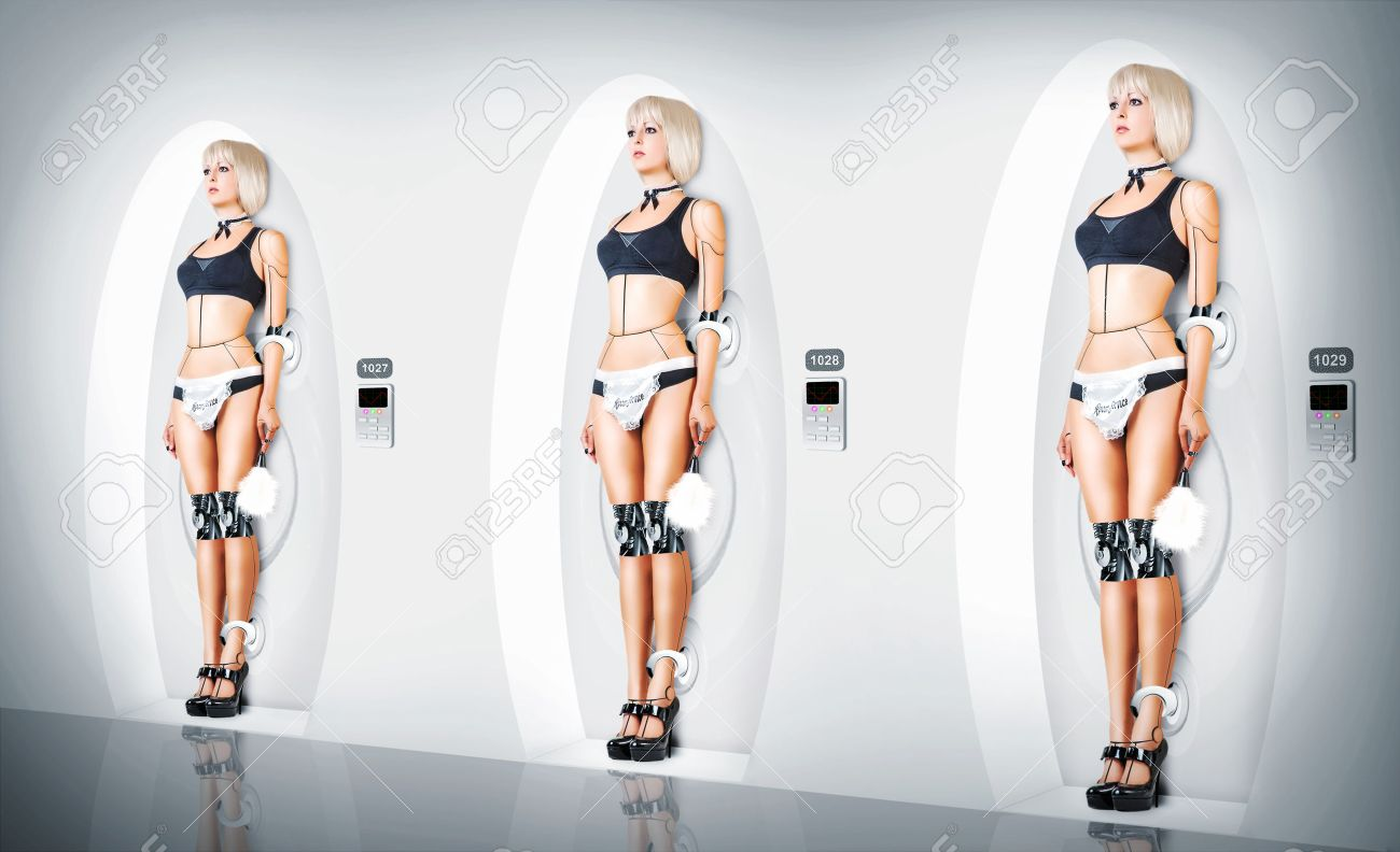 Three identical Female cyborg suit sexy maid. Robotic servants charging Stock Photo - 40818305