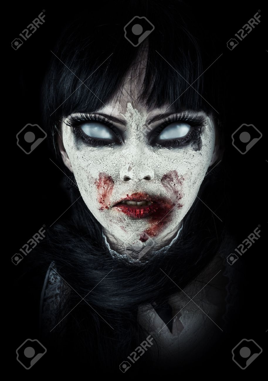 Scary zombie woman  with white eyes and bloody mouth Stock Photo - 40818306