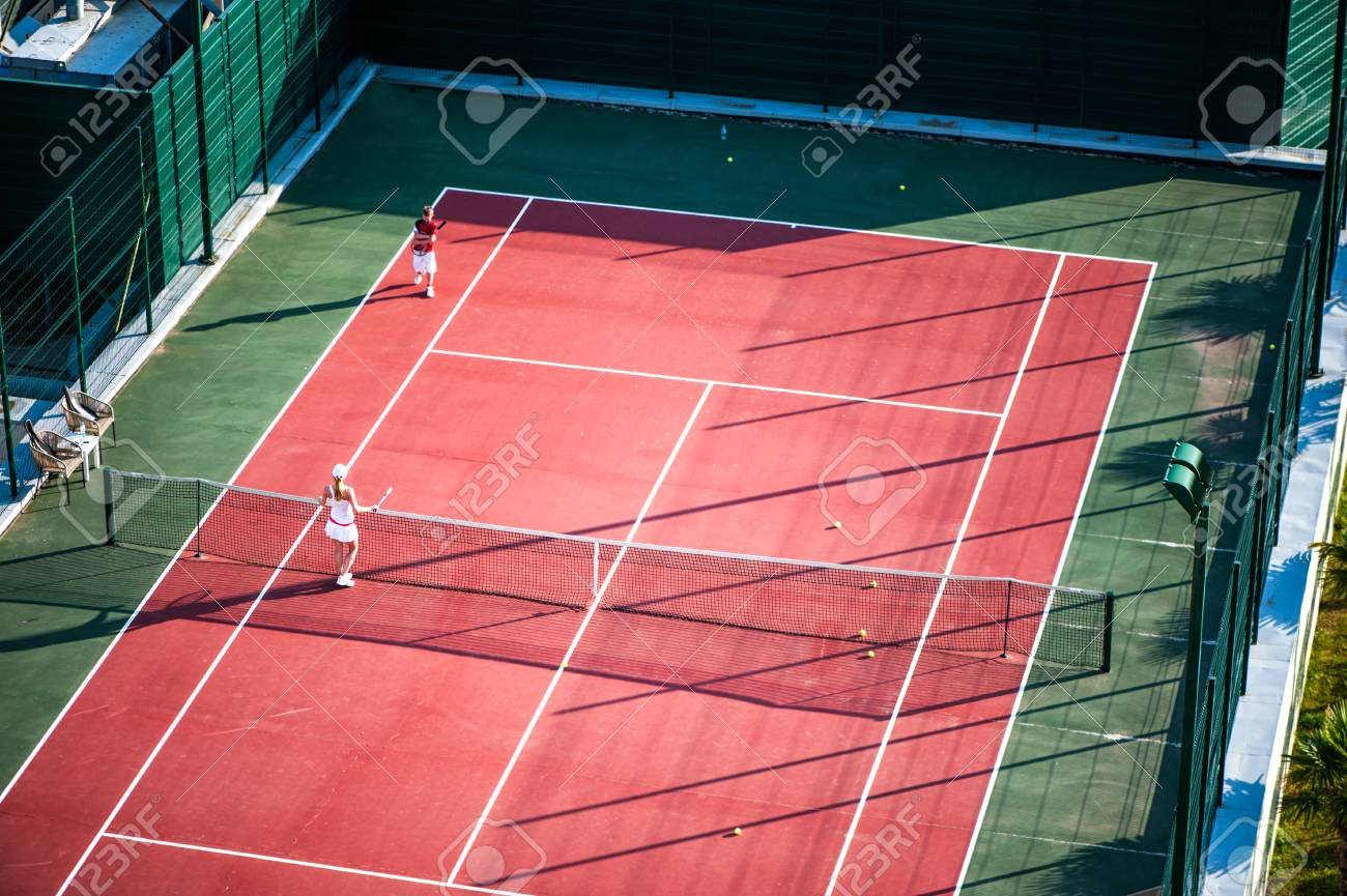 Two Noname Children Play On Tennis Court Outdoor Stock Photo