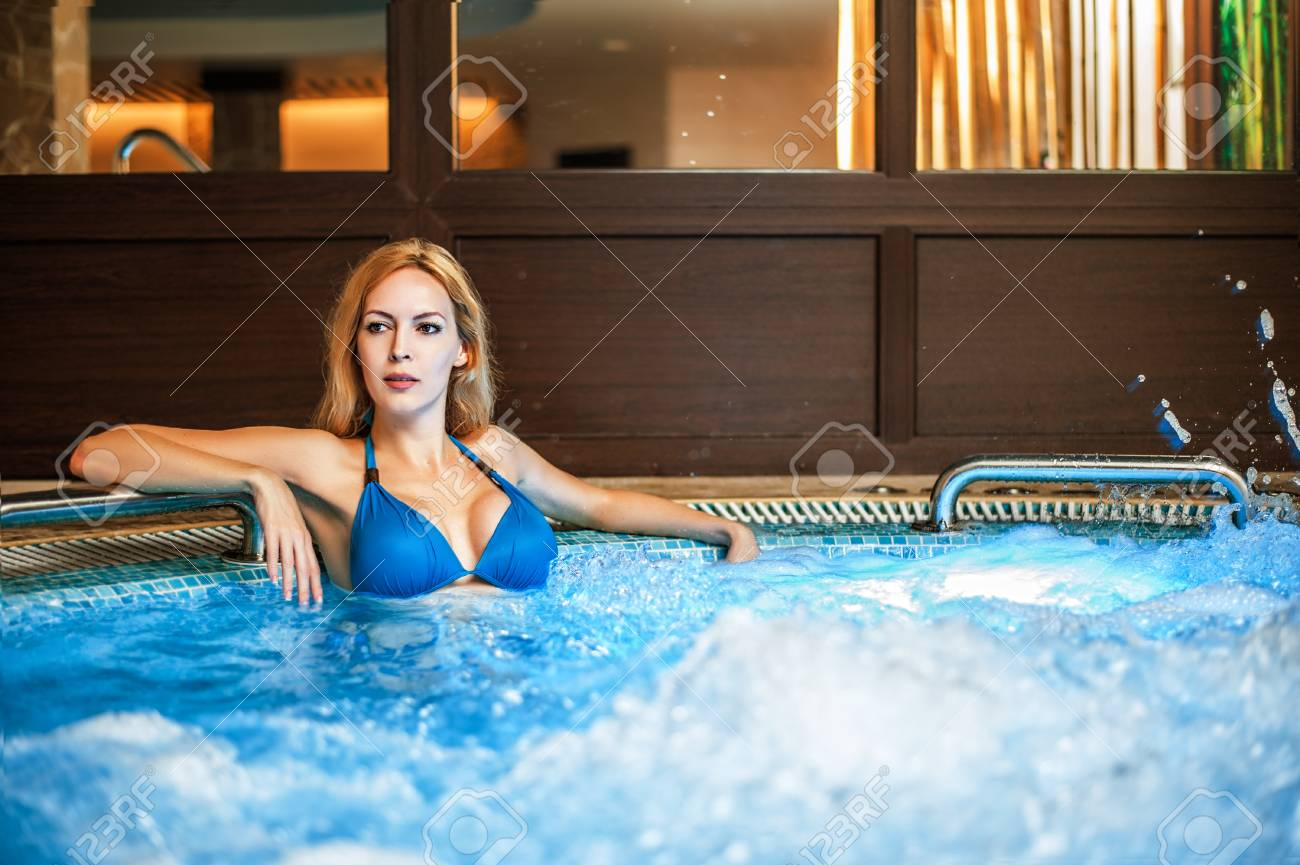Beautiful Woman Sits In Whirlpool Tube In Hot Wellness And Spa ...