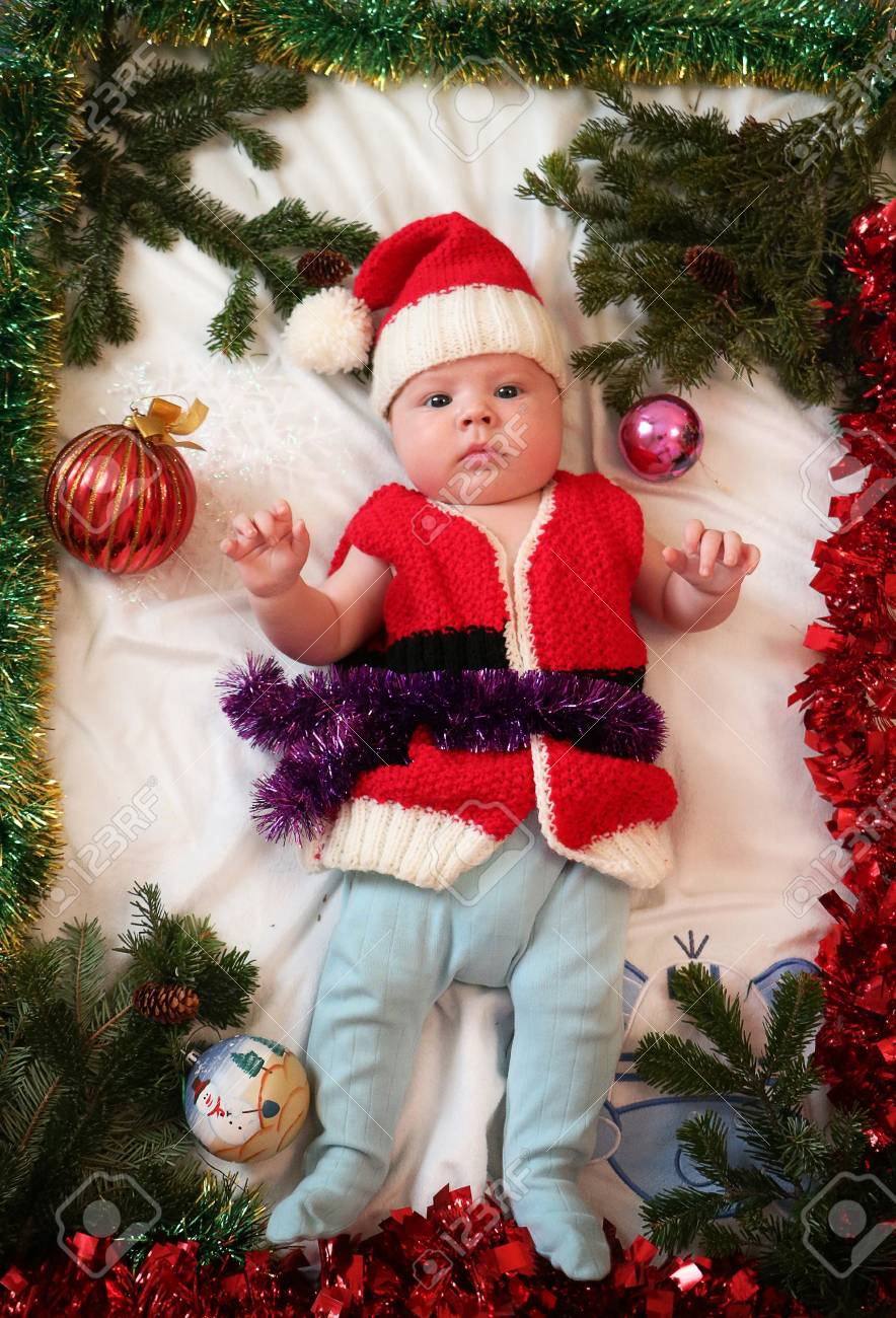 Baby first christmas. Beautiful little baby in Santa hat on Christmas  background with Christmas tree 43386ecf1e1