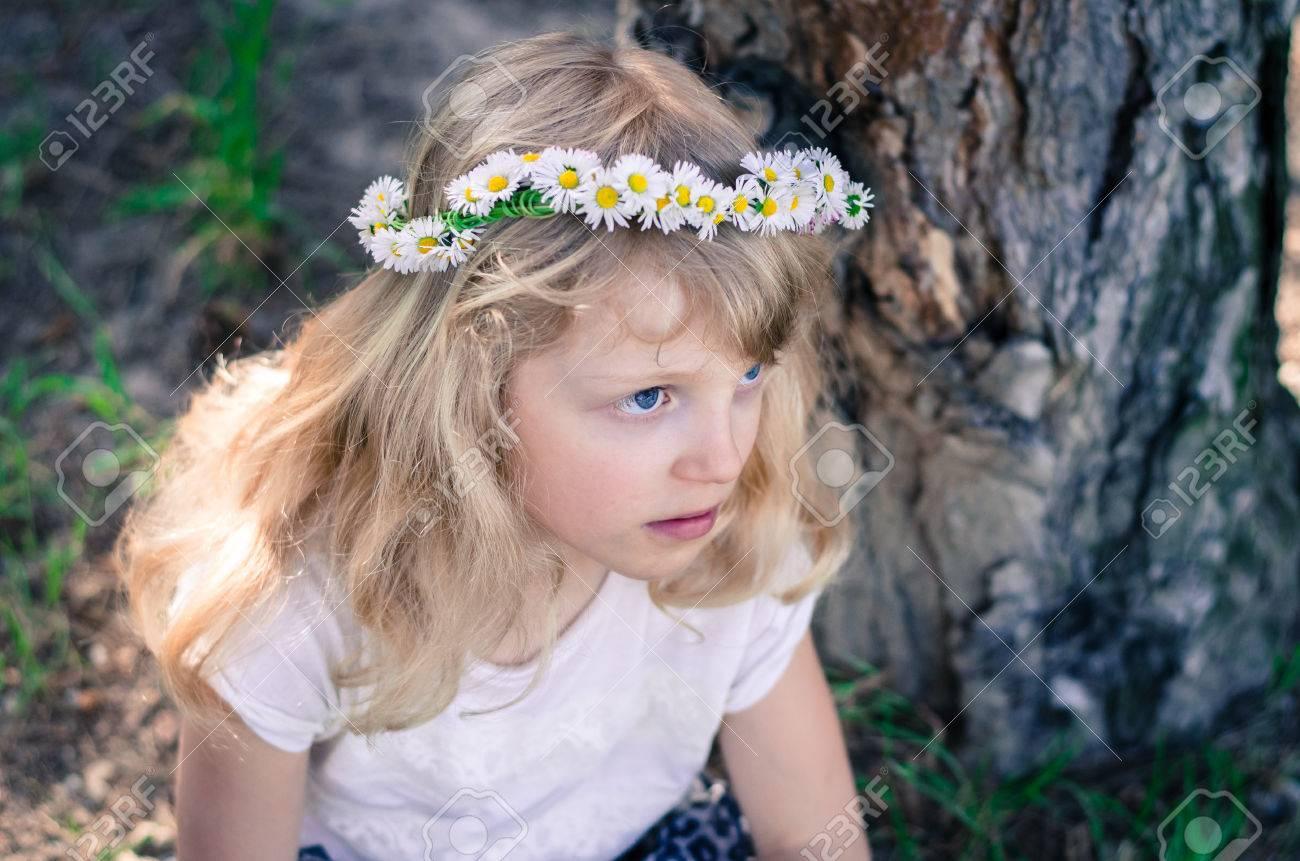 Adorable Little Blond Girl With Daisy Flower Headband Stock Photo