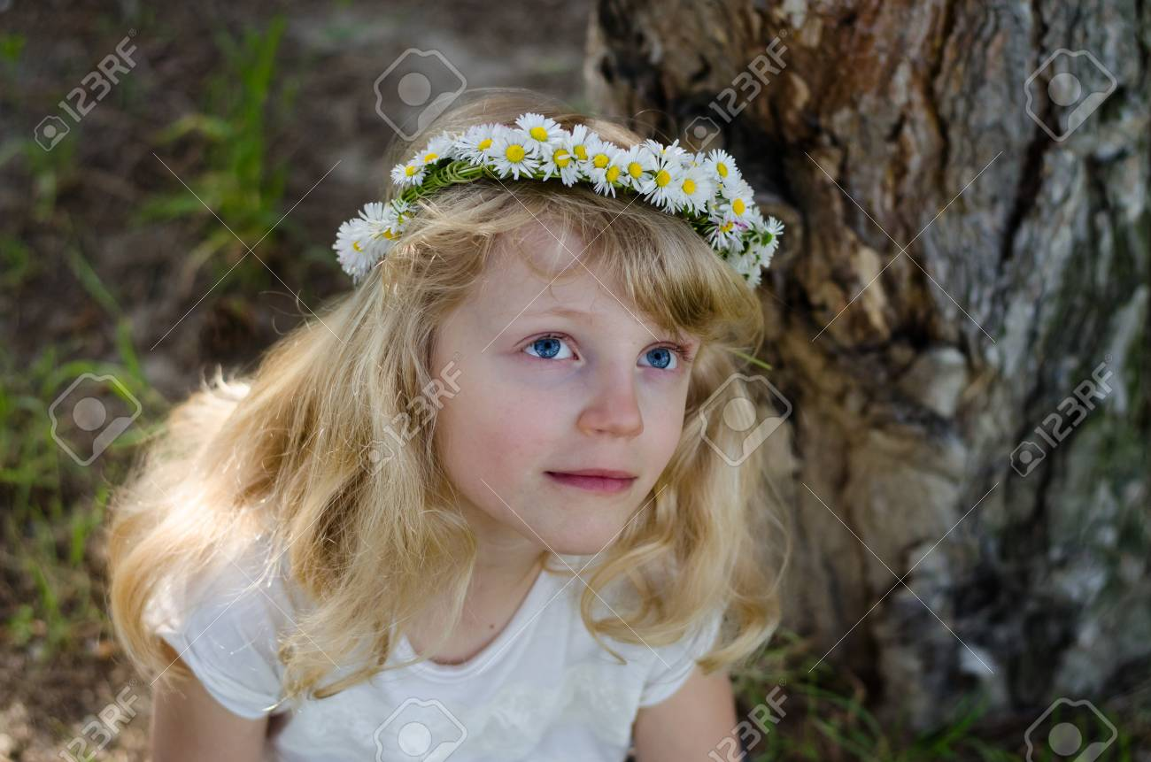 Adorable Smiling Little Blond Girl With Daisy Flower Headband Stock
