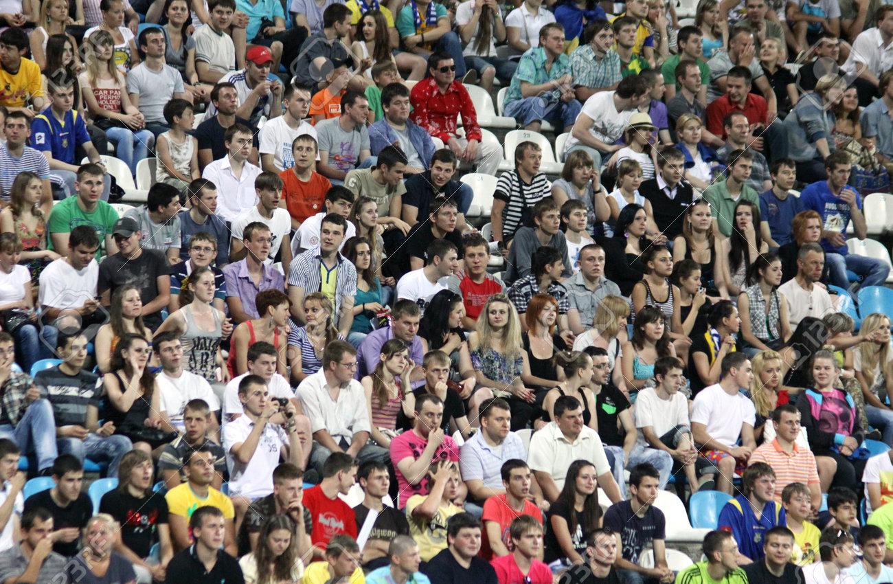 KYIV, UKRAINE - JUNE 1, 2011: People watch the Friendly football game between Ukraine and Uzbekistan national teams on June 1, 2011 in Kyiv, Ukraine Stock Photo - 9889498