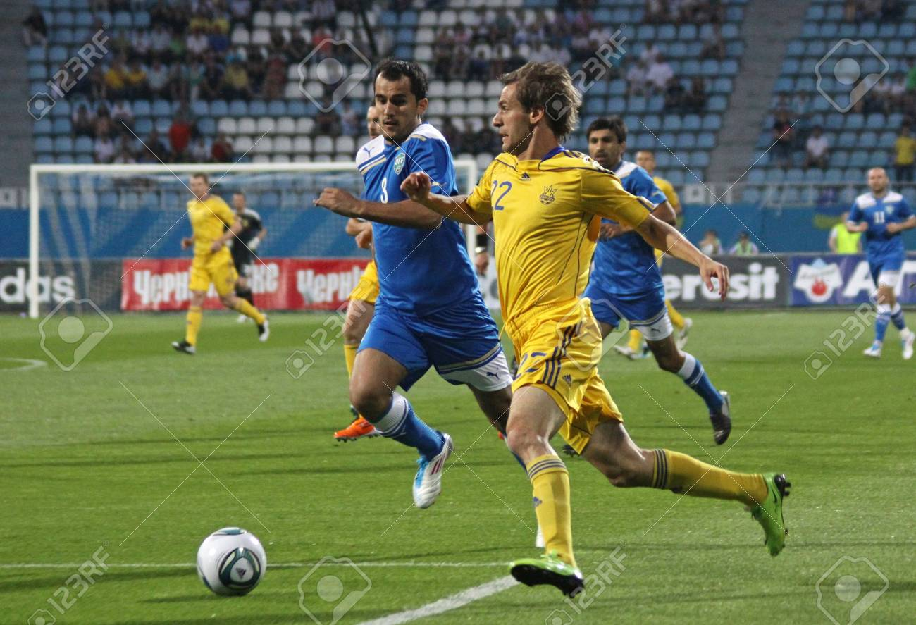 KYIV, UKRAINE - JUNE 1, 2011: Marko Devic of Ukraine (R) fights for a ball with Shavkat Mullajanov of Uzbekistan during their Friendly game on June 1, 2011 in Kyiv, Ukraine Stock Photo - 9889505