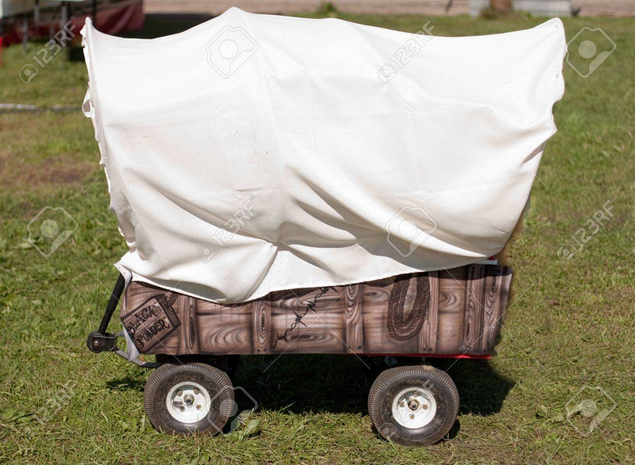Childs Red Wagon Turned Into A Covered Wagon With Room For Copyspace ...