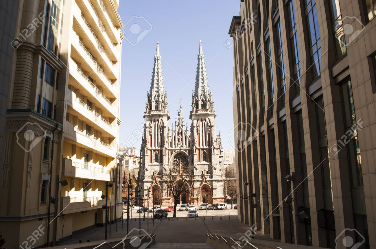 Beautiful Old Gothic Architecture Among Modern Contemporary Buildings.  Stock Photo   99640364