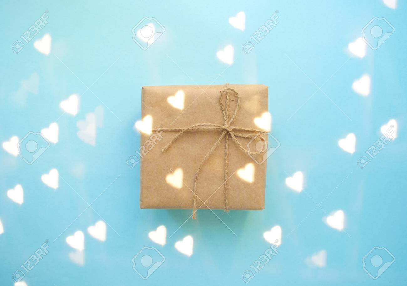 Gift Box Wrapped In Brown Colored Craft Paper And Tied With Tope