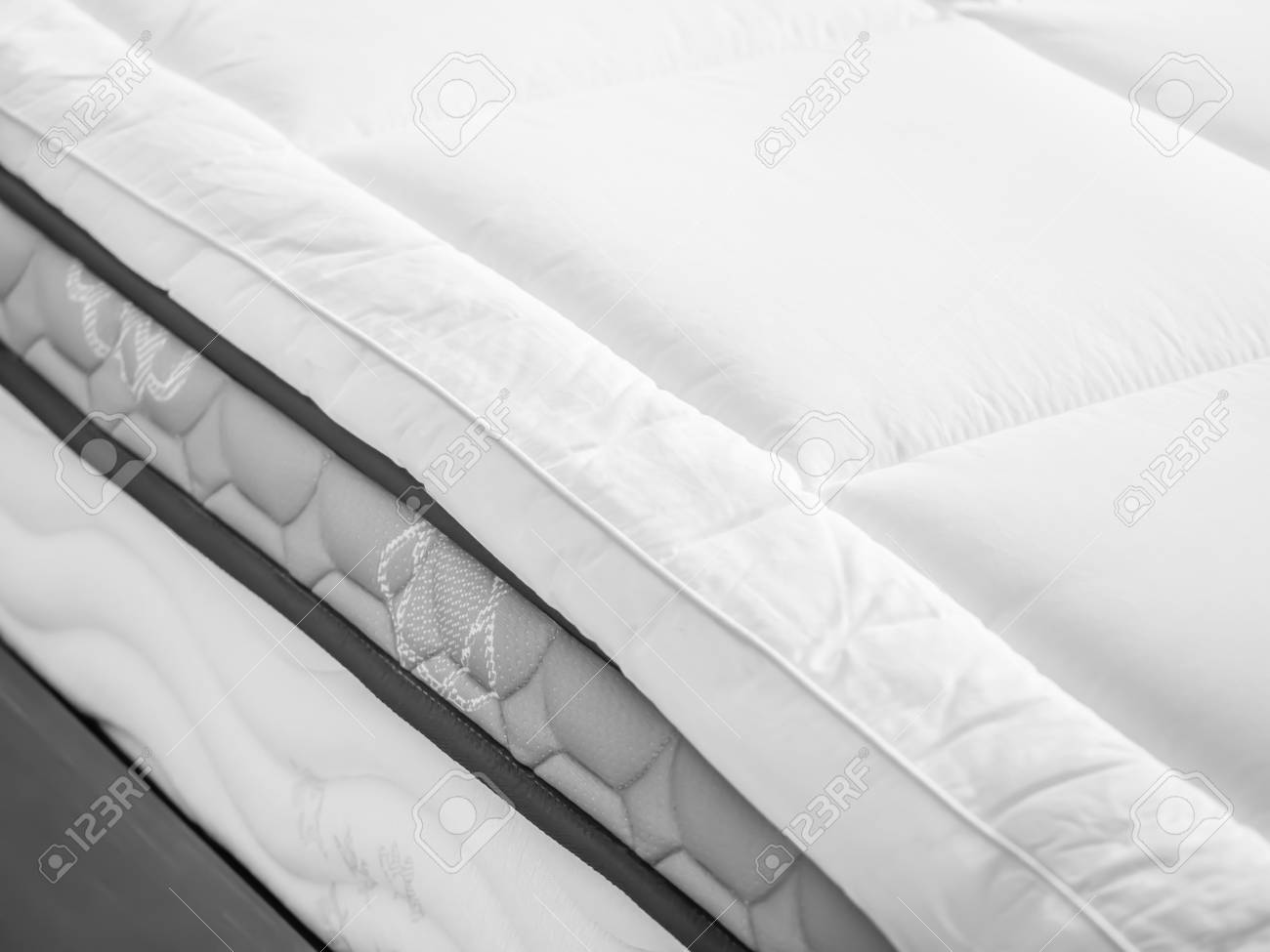 Bed topper on bed in bedroom - 92592890