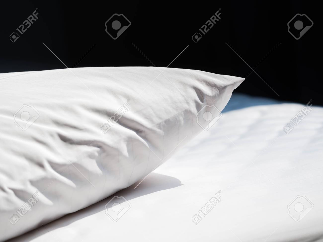 Stock Photo   White Wrinkles Dust Mites Pillow And Bedding Cover With Black  Background In The Bedroom.