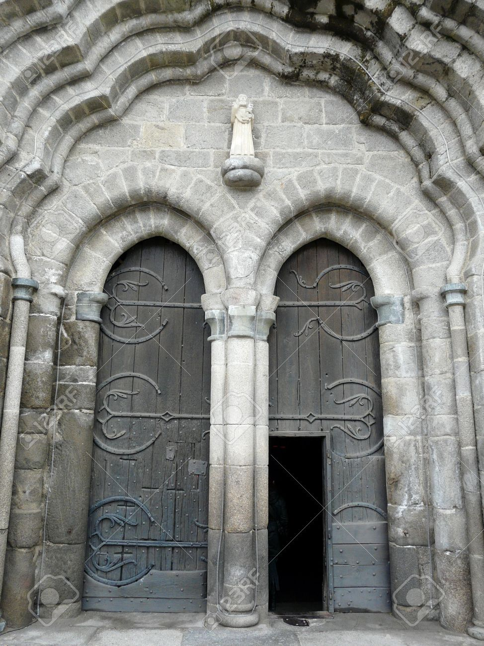 Arched medieval church doors with stone lintel in Le Dorat France Stock Photo - 4742415 & Arched Medieval Church Doors With Stone Lintel In Le Dorat France ...