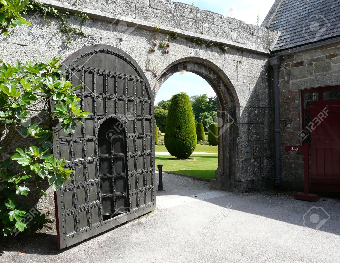 Old Wooden Arched Door At Lanhydrock Castle Near Bodmin In Cornwall England  Stock Photo   5243948