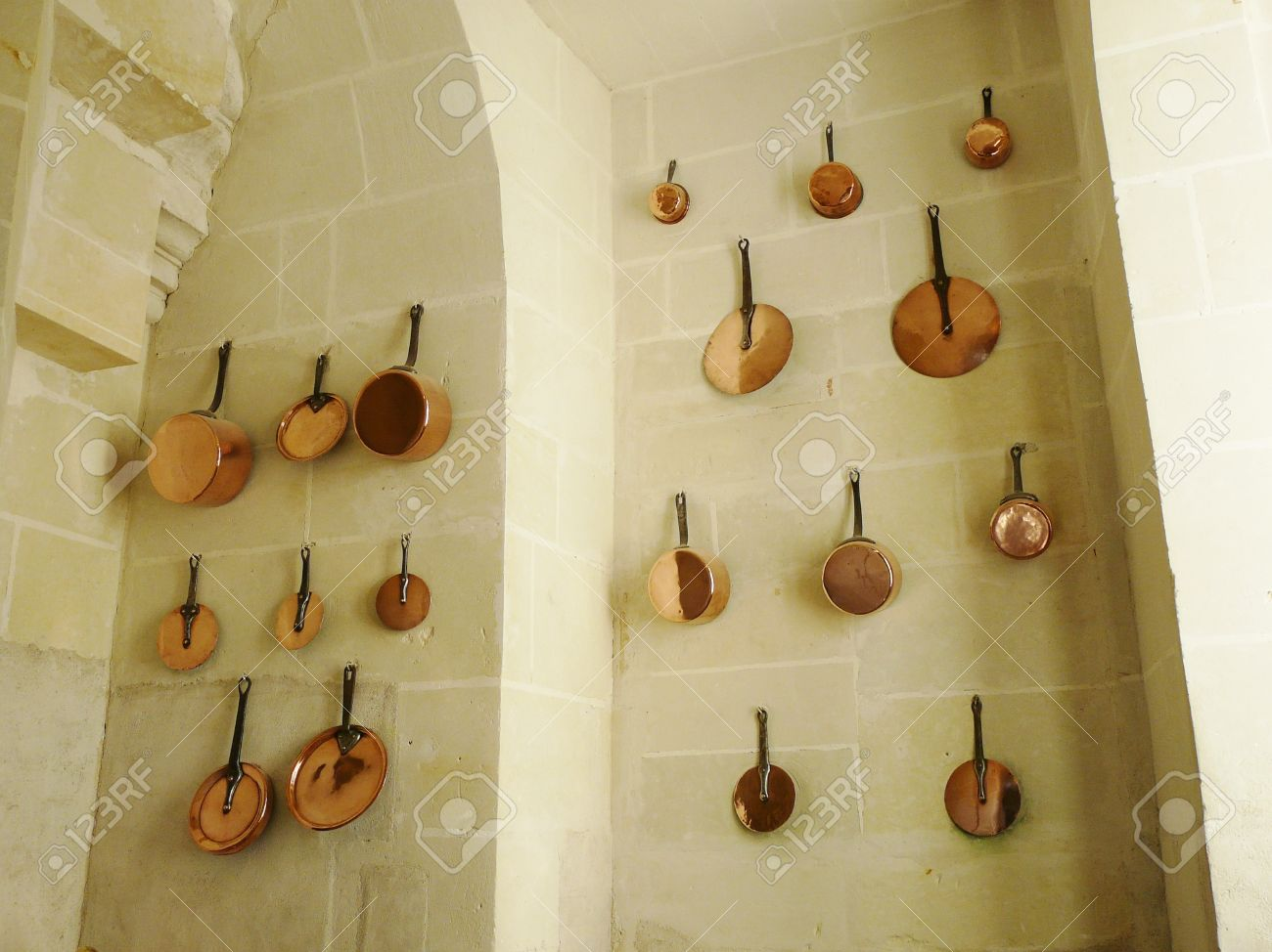 Shiny Copper Pots And Pans Hanging On The Wall Of A Medieval Stock Photo Picture And Royalty Free Image Image 11114955
