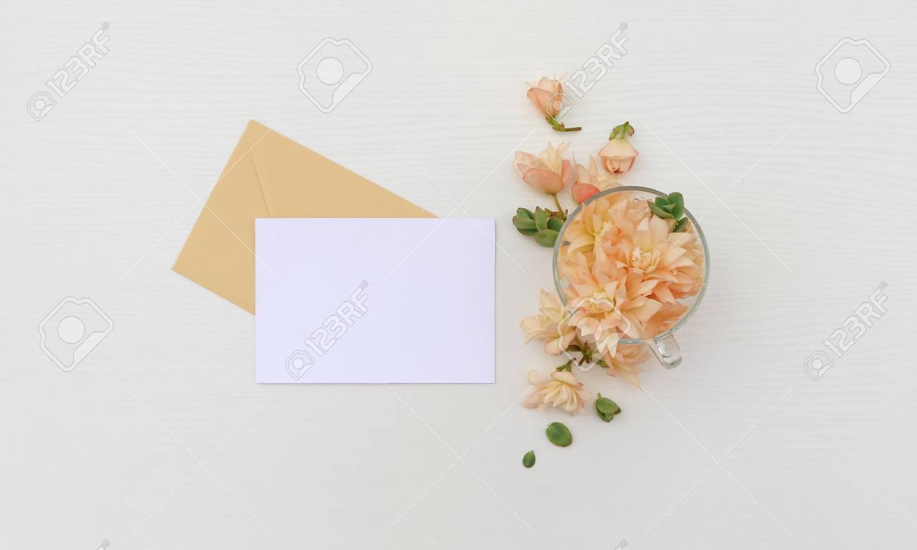 Postcard Mockup Whith Flowers And Envelope On Wooden Background