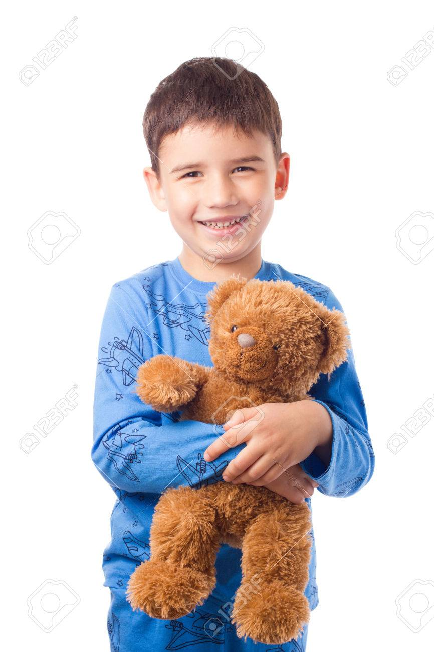 Cute Boy In Pajamas Hugging A Teddy Bear Stock Photo, Picture And ...