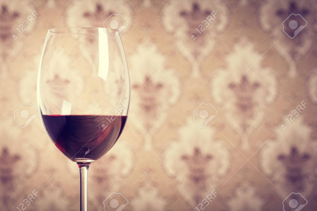 832464fa7461 Glass of wine on wooden table against of vintage wallpaper background Stock  Photo - 43537569