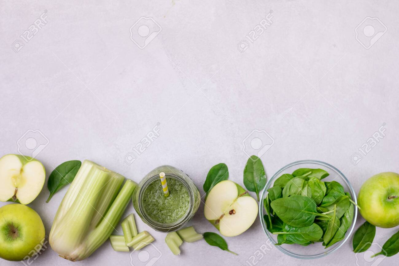 Glass Jar of Healthy Green Smoothie Detox Drink wirh Green Apple Celery and Raw Spinach Diet Beverage Copy Space - 148273223