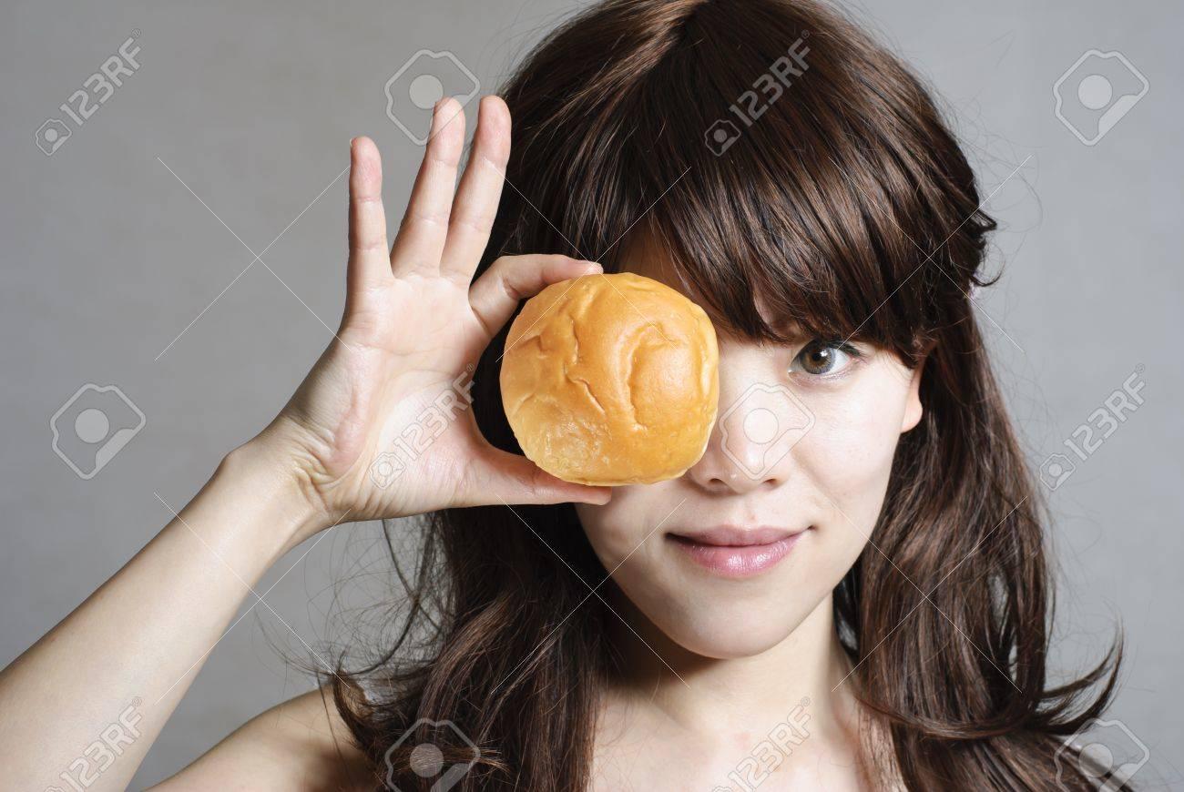 hungry beautiful girl eats a tasty hamburger Stock Photo - 13875226