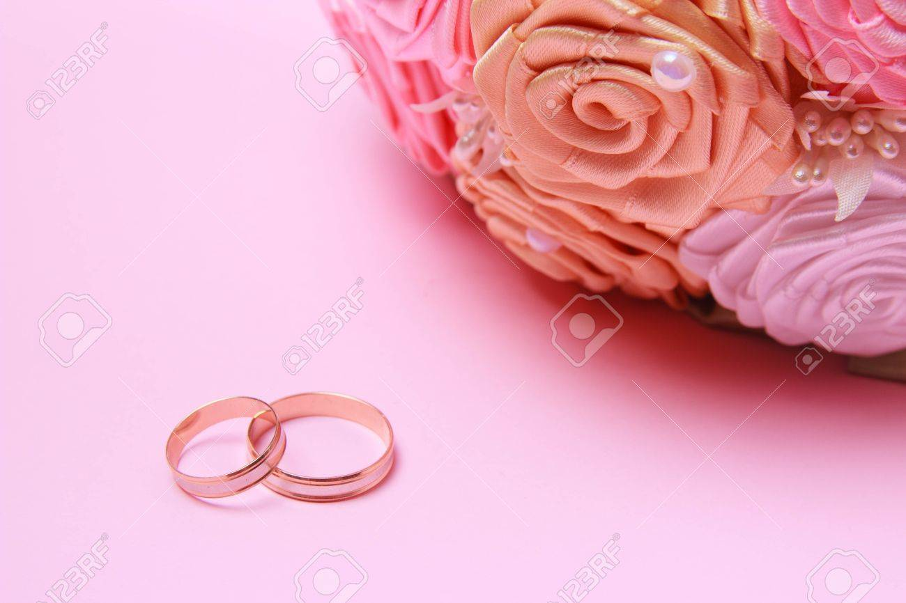 Wedding Bouquet With Wedding Rings On Pink Background Stock Photo ...
