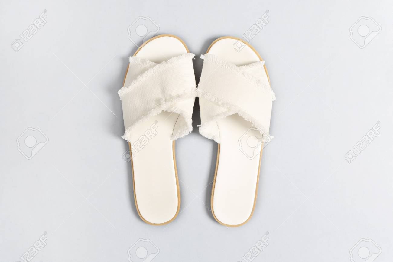 boy sale online wide selection of colors Women's white fabric sandals on a gray background