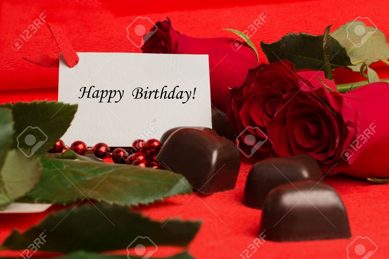 Tag Happy Birthday With Red Roses And Candies In A Shape Of