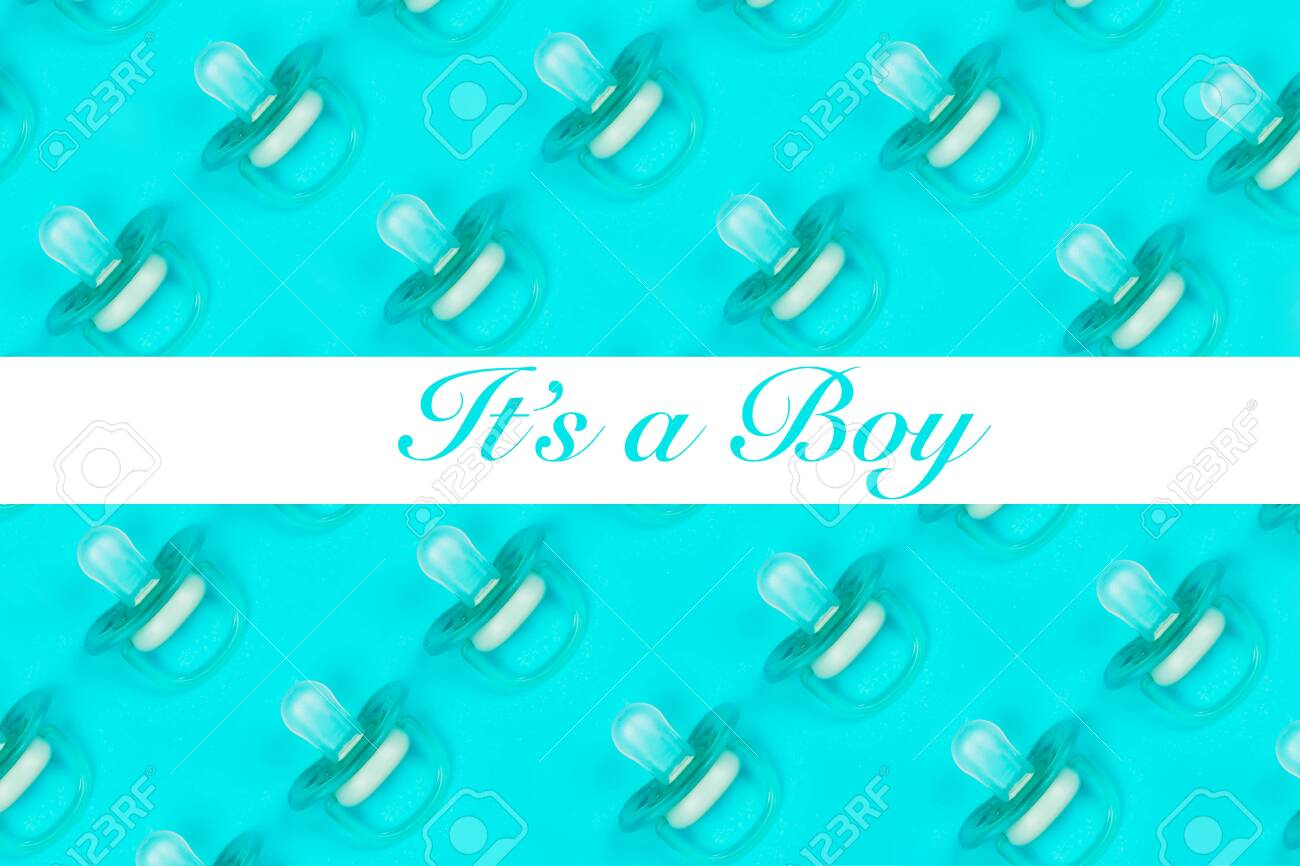 Pattern blue baby pacifiers, dummy with rubber on blue background with text Its a boy. Flat lay. Top view. - 143562540