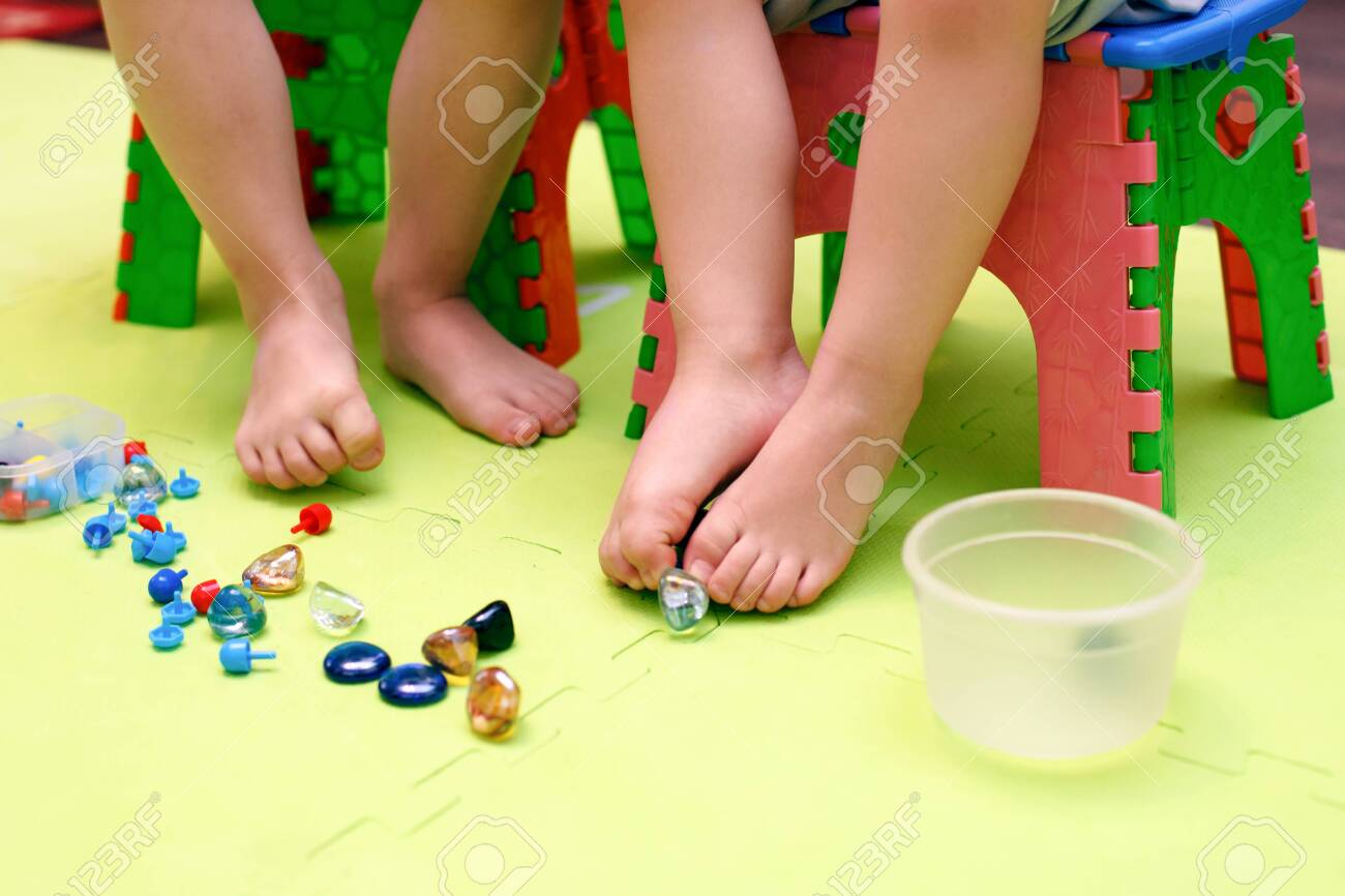Kids play with mosaic pieces, glass stones  Orthopedic game,