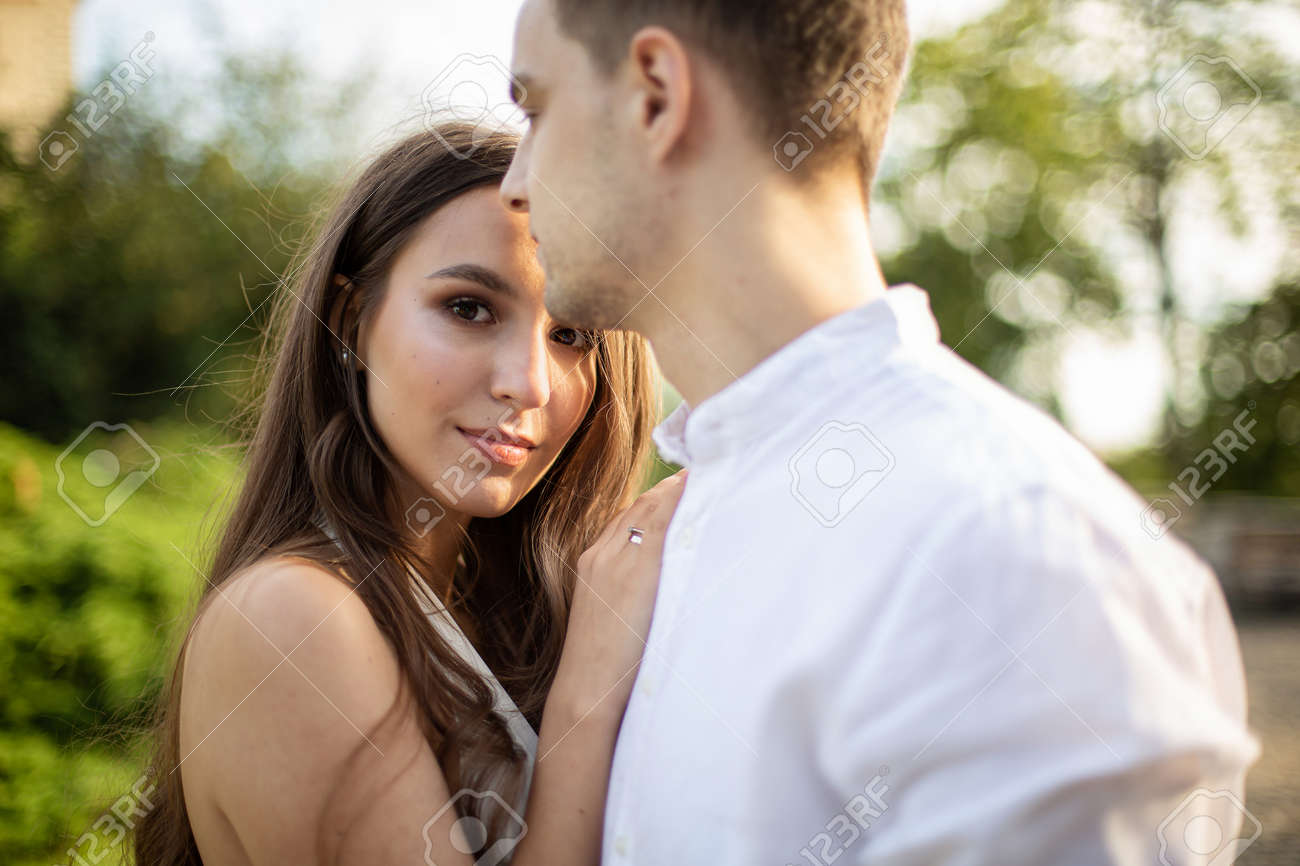 Young white couple in park european man and dark long hair woman - 166358232