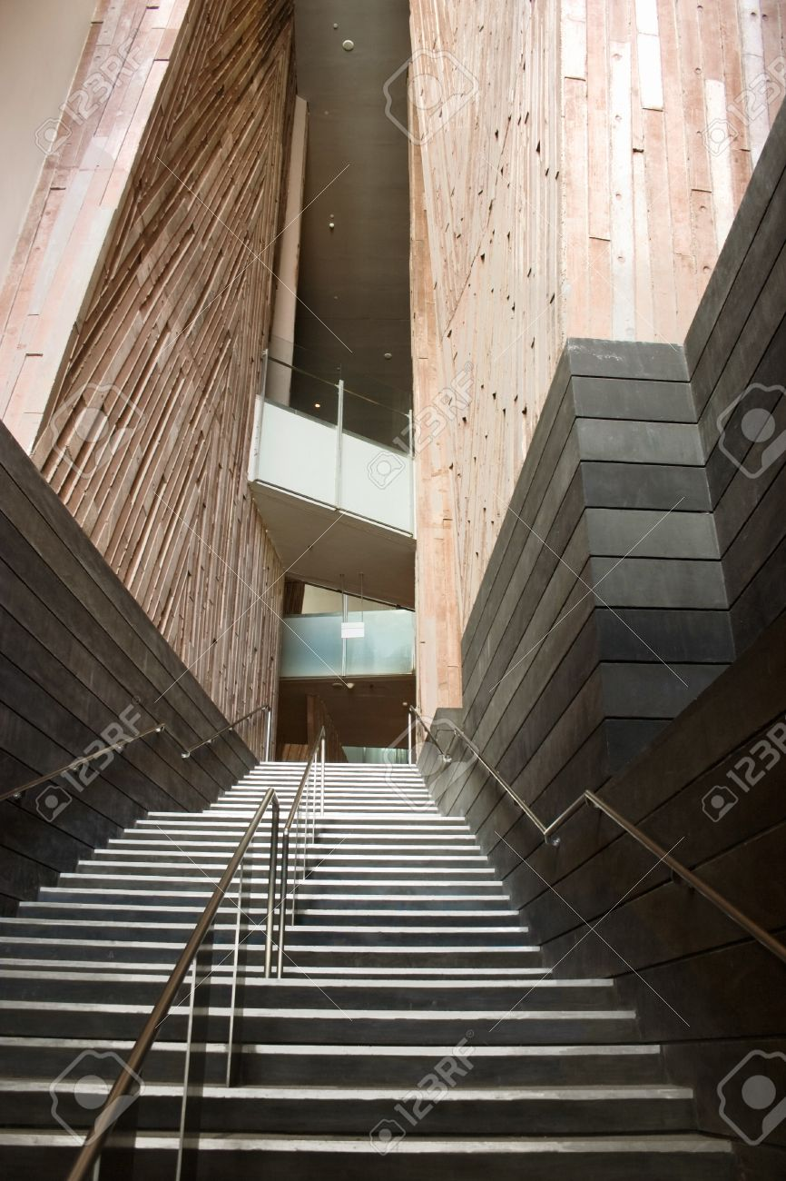 Narrow Stairs With Handrails And Wooden Walls In Modern Architecture
