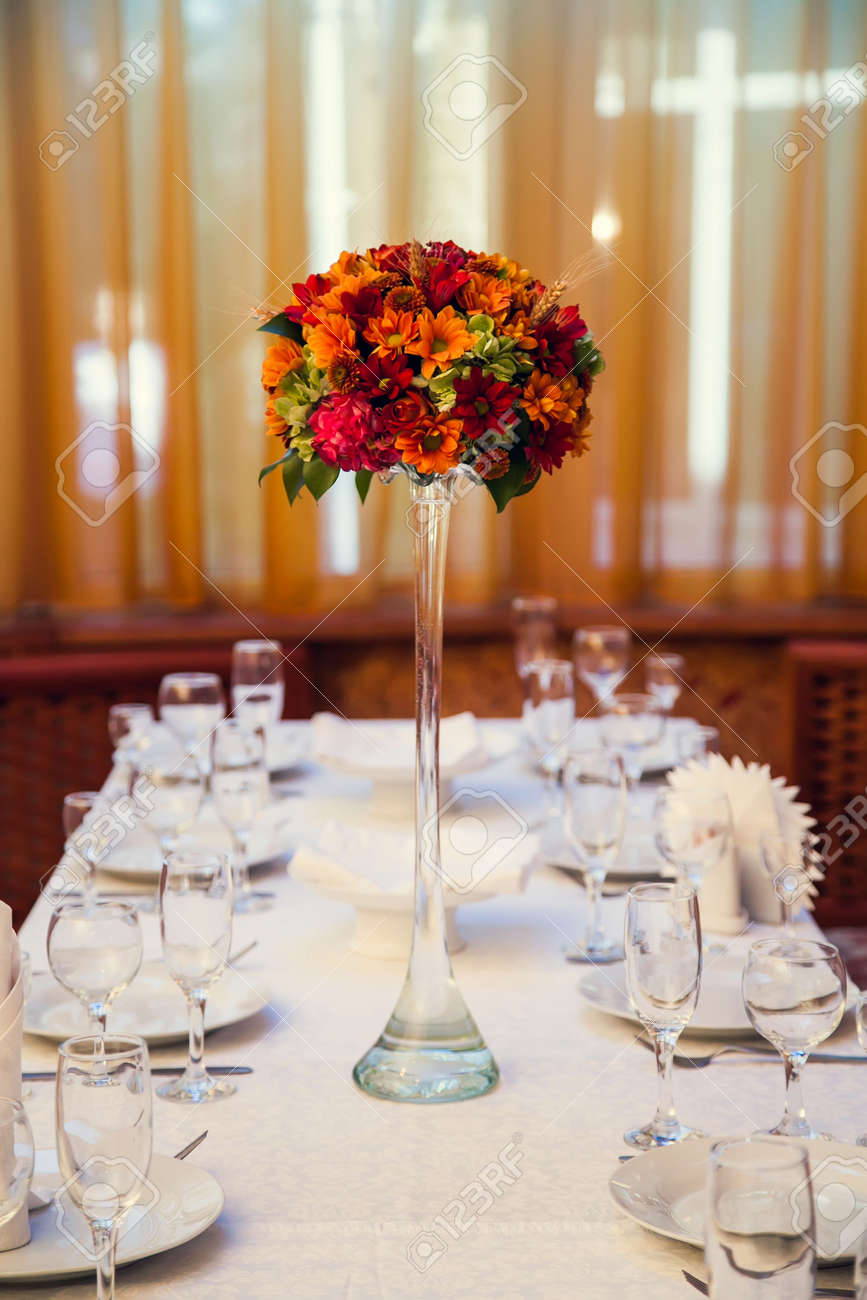 Autumn bouquet of flowers decorates the festive table in the restaurant. - 156410878