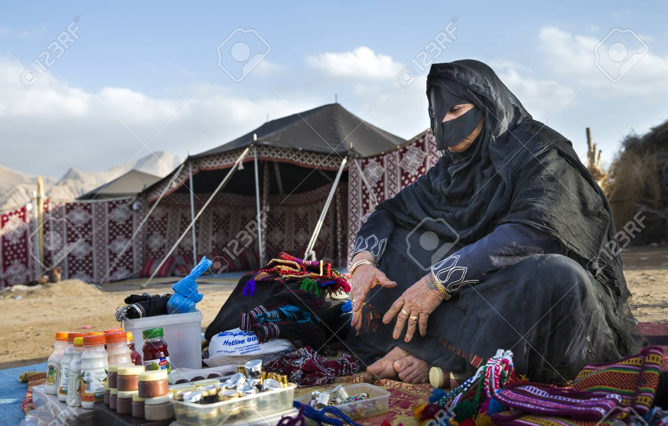 Muscat, Oman, February 4th, 2017: omani woman is selling souvenirs