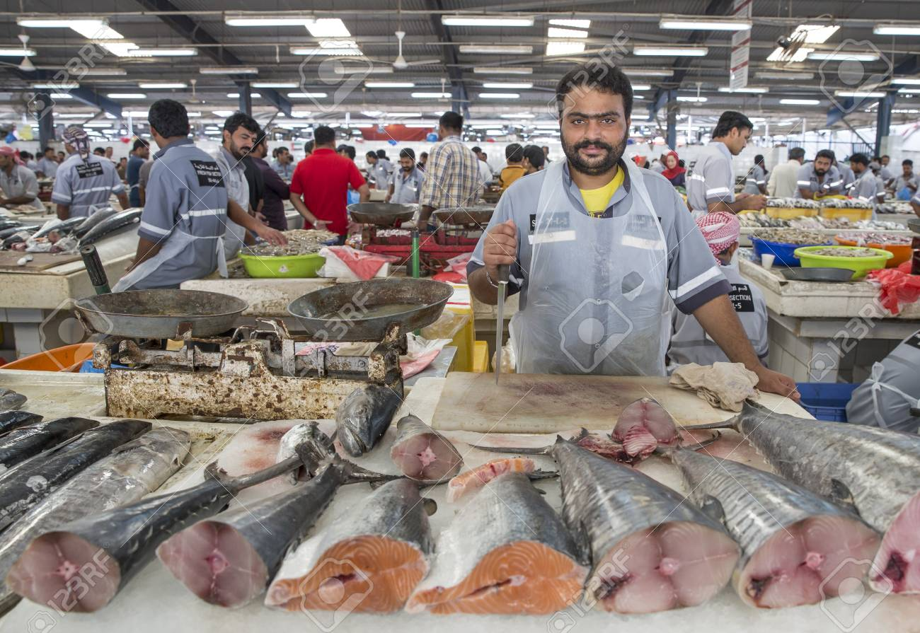 Dubai, UAE, 31st March, 2017: man selling fish at a Deira fish
