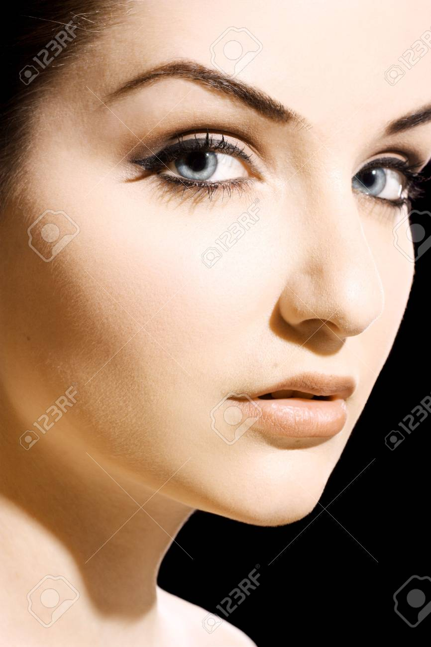 A close up of a beautiful young woman looking at the camera. Stock Photo - 6626035