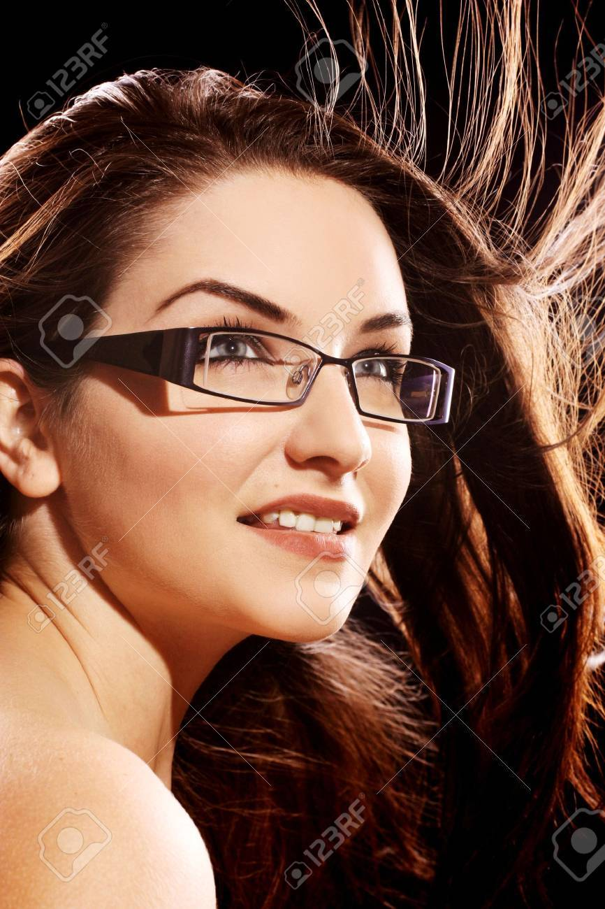 fashionable glasses for women  A Beautiful Young Woman Wearing Fashionable Glasses With Her ...
