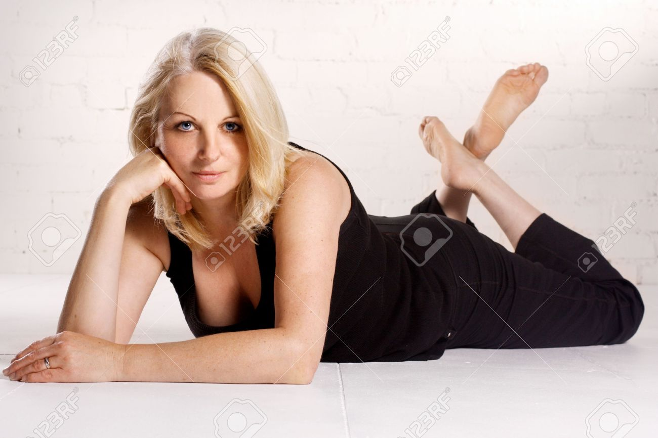 A beautiful blond middle aged woman wearing black in a white studio. Stock Photo - 7561823