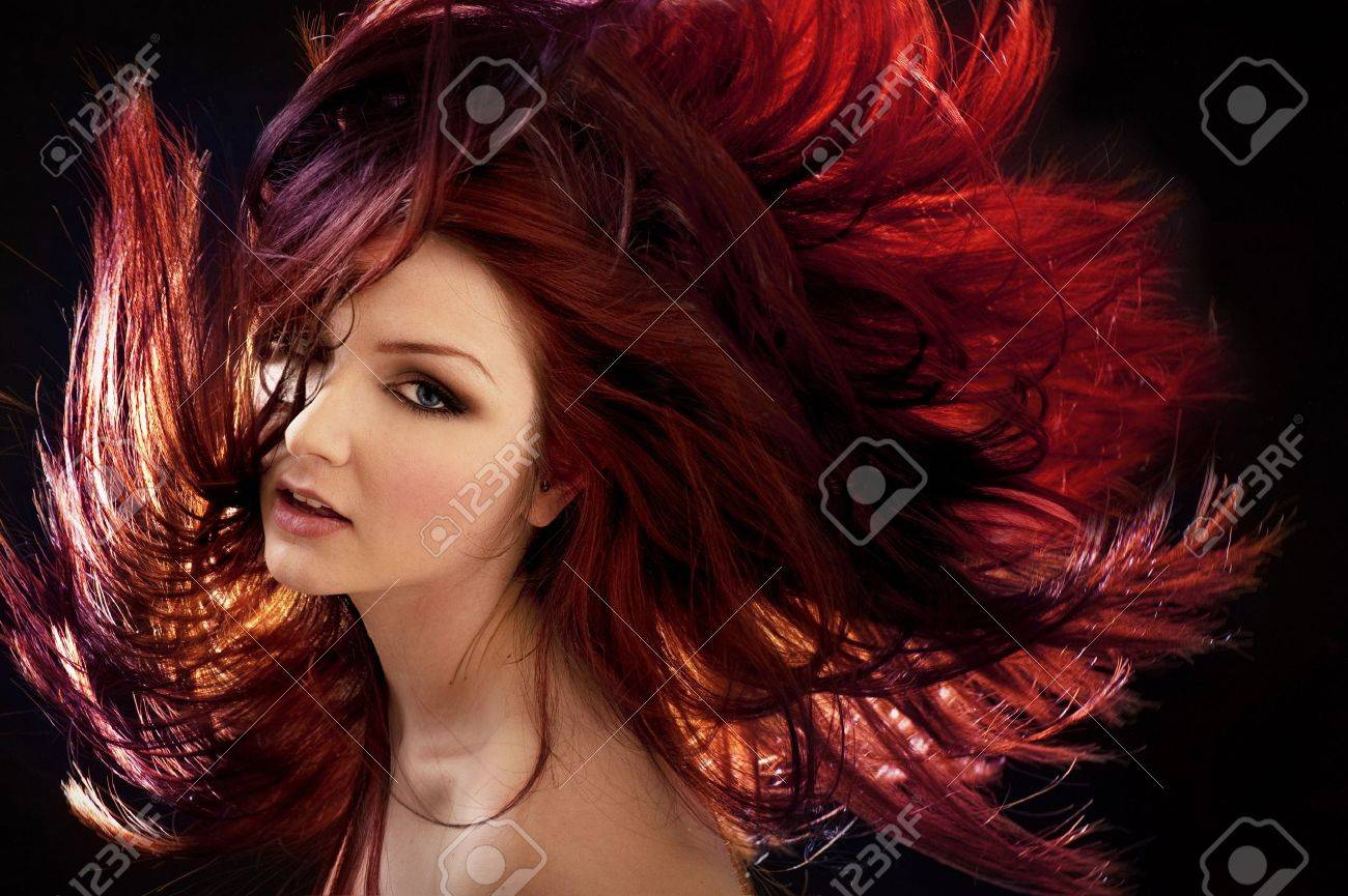 A beautiful woman with crazy hair - 12918507