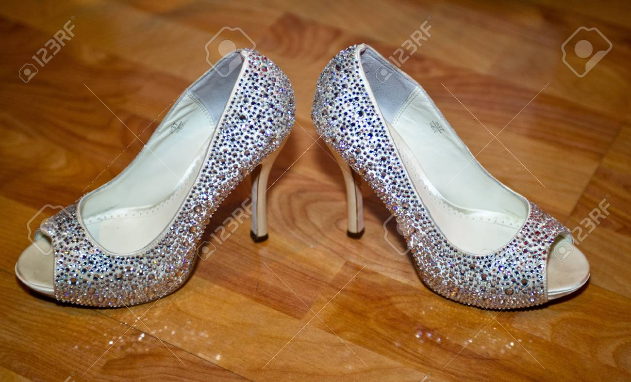 0a45f4ad7d6daf Beautiful beaded wedding shoes on wooden floor Stock Photo - 13572605