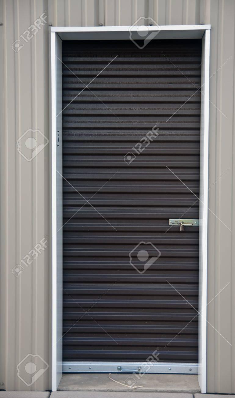Brown metal door with padlock of an outdoor storage unit Stock Photo - 14821042 & Brown Metal Door With Padlock Of An Outdoor Storage Unit Stock ...