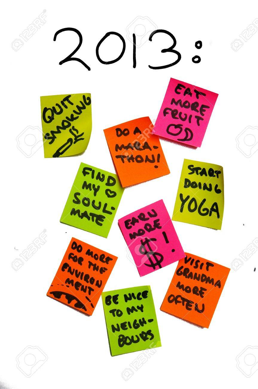Post it notes containing new year resolutions for the year of 2013. The many different and ambitious (life) goals give the impression of overambition. Stock Photo - 16891495
