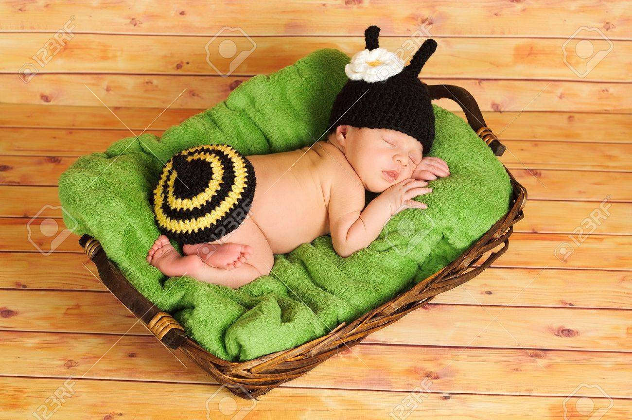 Stock Photo - Three 3 week old newborn baby girl wearing a crocheted black and yellow bumblebee costume The infant is sleeping on a green blanket inside of ... & Three 3 Week Old Newborn Baby Girl Wearing A Crocheted Black.. Stock ...