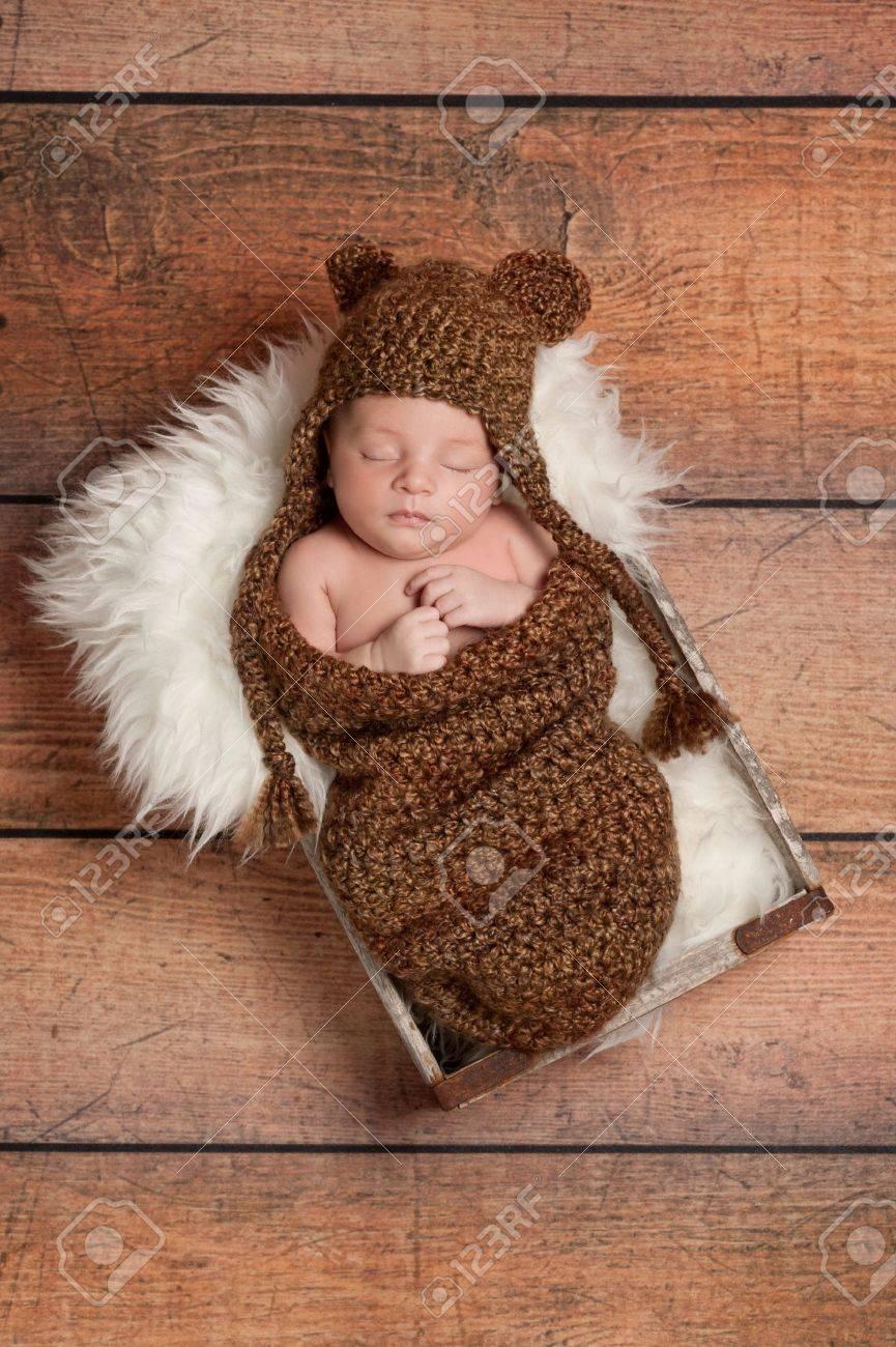 f531873e7cf Sleeping Newborn Baby Boy Wearing a Bear Hat Stock Photo - 17718878