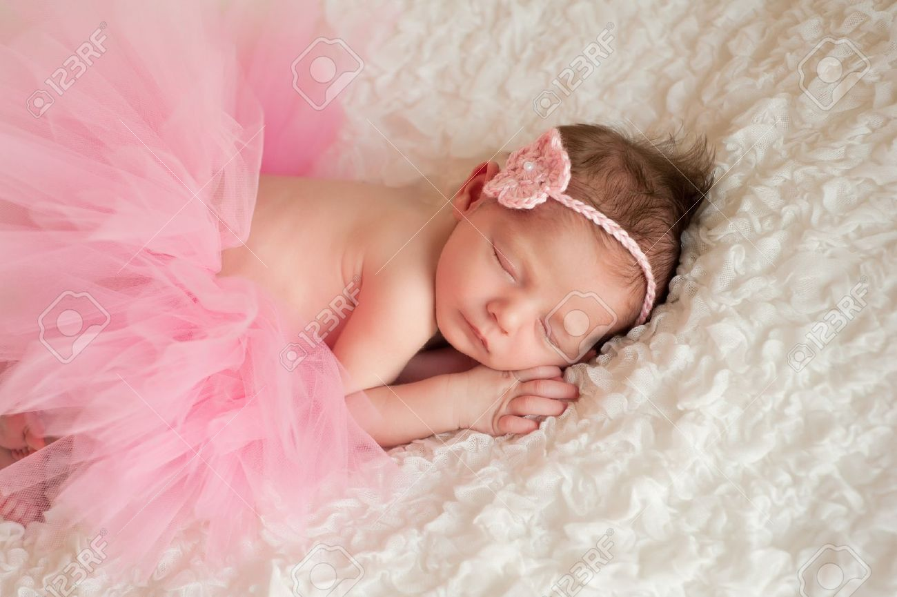 Newborn baby girl wearing a pink tutu stock photo 18764860