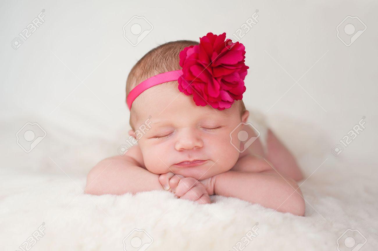 A Portrait Of A Beautiful Newborn Baby Girl Wearing A Hot Pink